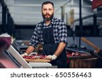 bearded butcher dressed in a... | Shutterstock . vector #650556463
