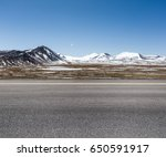 empty road on snow area plateau ... | Shutterstock . vector #650591917