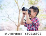 young asian boy taking photo by ... | Shutterstock . vector #650616973