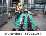 two factory workers monitoring... | Shutterstock . vector #650631067