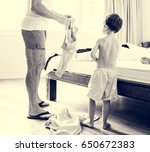 on the bedroom son and dad put... | Shutterstock . vector #650672383