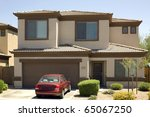 Modern two-story single family house with garage and car in driveway - stock photo