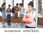 school friends bullying a sad... | Shutterstock . vector #650678323
