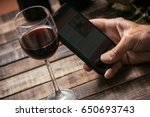 man tasting a glass of red wine ...   Shutterstock . vector #650693743