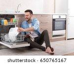 happy handsome man unloading... | Shutterstock . vector #650765167