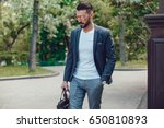 stylish man with a beard and in ... | Shutterstock . vector #650810893