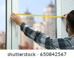 young man taking measure of... | Shutterstock . vector #650842567