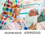 mother carrying her child in... | Shutterstock . vector #650905333