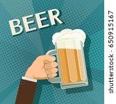 human hand holds a mug of beer. ...   Shutterstock . vector #650915167