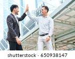 happy business team making high ... | Shutterstock . vector #650938147