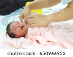 crying young baby after taking ... | Shutterstock . vector #650966923