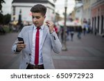 manager listening to music on... | Shutterstock . vector #650972923