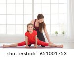 young mother and daughter doing ... | Shutterstock . vector #651001753