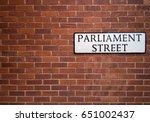 wall with a sign of parliament... | Shutterstock . vector #651002437