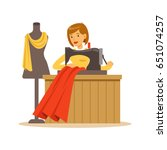 woman tailor sewing a red dress ...   Shutterstock .eps vector #651074257