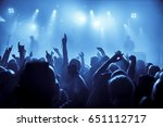 silhouettes of concert crowd in ... | Shutterstock . vector #651112717