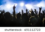 silhouettes of concert crowd in ... | Shutterstock . vector #651112723