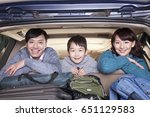 chinese family in packed car | Shutterstock . vector #651129583