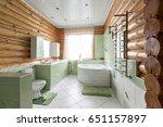 The Bathroom In A Rustic Log...