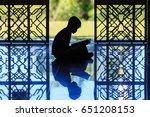 silhouette of a muslim kids... | Shutterstock . vector #651208153