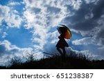 umbrella and pretty girl... | Shutterstock . vector #651238387
