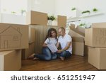 happy family moves into a new... | Shutterstock . vector #651251947