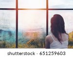 lonely woman sitting in front... | Shutterstock . vector #651259603