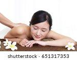 woman getting a body massage | Shutterstock . vector #651317353