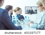 Small photo of Video conference with employees at worldwide finance company