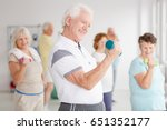older man exercising biceps