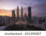 Small photo of KUALA LUMPUR, MALAYSIA - May 18 2017 : Petronas Twin Tower during the twillight of the dusk at golden hour. The tallest twin towers stand at 451.9m.