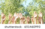 young people putting hands in... | Shutterstock . vector #651460993