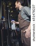male brewery worker spraying... | Shutterstock . vector #651478237