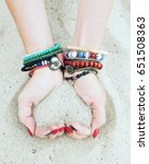 hands with sand  forming heart. ...   Shutterstock . vector #651508363