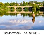 man fly fishing on the river... | Shutterstock . vector #651514813