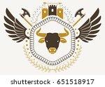 vintage winged emblem created... | Shutterstock .eps vector #651518917