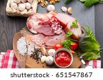 meat delicacy on wooden plate   Shutterstock . vector #651547867