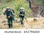 Small photo of Soldiers of the Russian army march through the forest belt during a combat operation