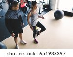 personal trainer assisting... | Shutterstock . vector #651933397