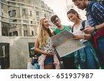 tourist friends discovering... | Shutterstock . vector #651937987