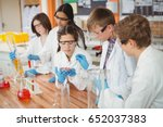 attentive school kids doing a... | Shutterstock . vector #652037383