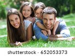 happy family outdoors  | Shutterstock . vector #652053373