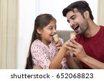 father sharing ice cream with... | Shutterstock . vector #652068823