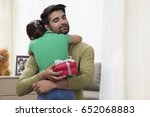 father hugging daughter holding ... | Shutterstock . vector #652068883