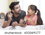 father and daughter using... | Shutterstock . vector #652069177