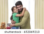 father and daughter embracing | Shutterstock . vector #652069213