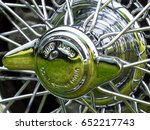 Small photo of Shiny Chromed wired spokes of a classic motorcar wheel