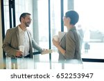 happy colleagues with drinks... | Shutterstock . vector #652253947