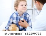 doctor examining a child ... | Shutterstock . vector #652299733