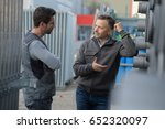 two employees working in factory | Shutterstock . vector #652320097